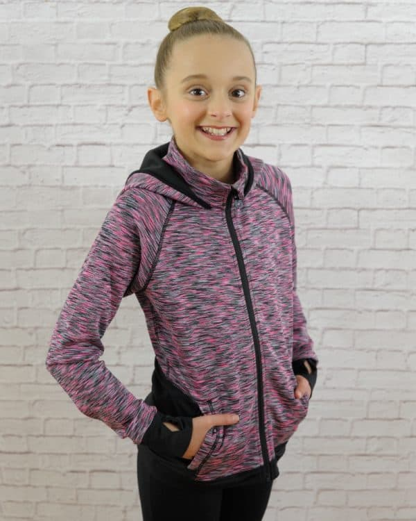 A girl smiles while wearing a jacket.