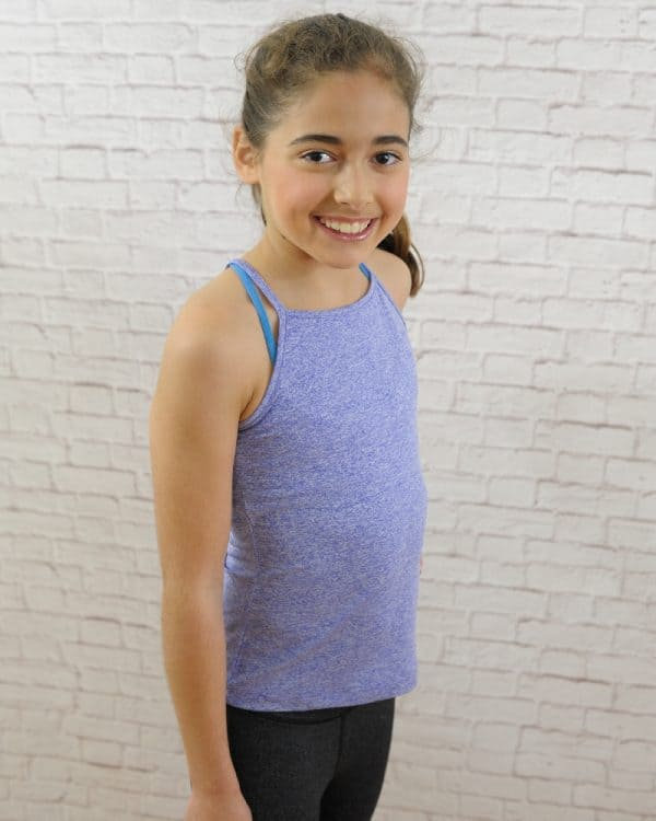 Smiling young athelete in comfy purple Zuu Razor Tank