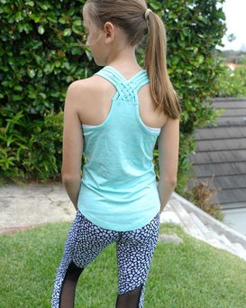 A girl wears and shows the back detail of a pair of leggings and sleeveless top activewear.