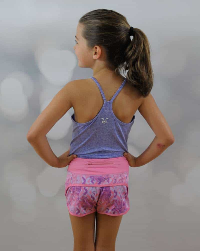 A girl standing backward wearing pink short and halter top thumbnail.