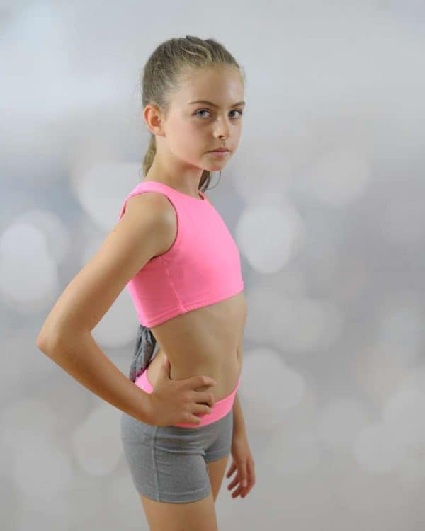 Pink stylish top and grey fitted shorts