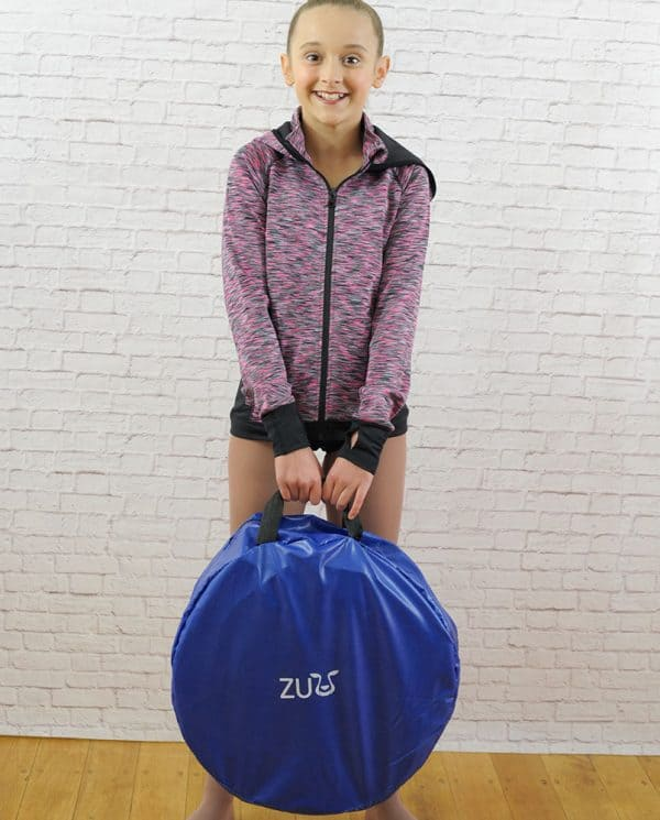 A girl holding a Zuu brand, blue bag of rollout beam.