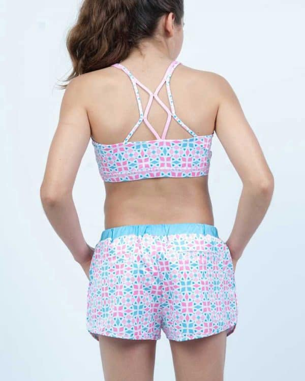Tidewater blue Rhythmic Shorts for young athletes paired with sports top