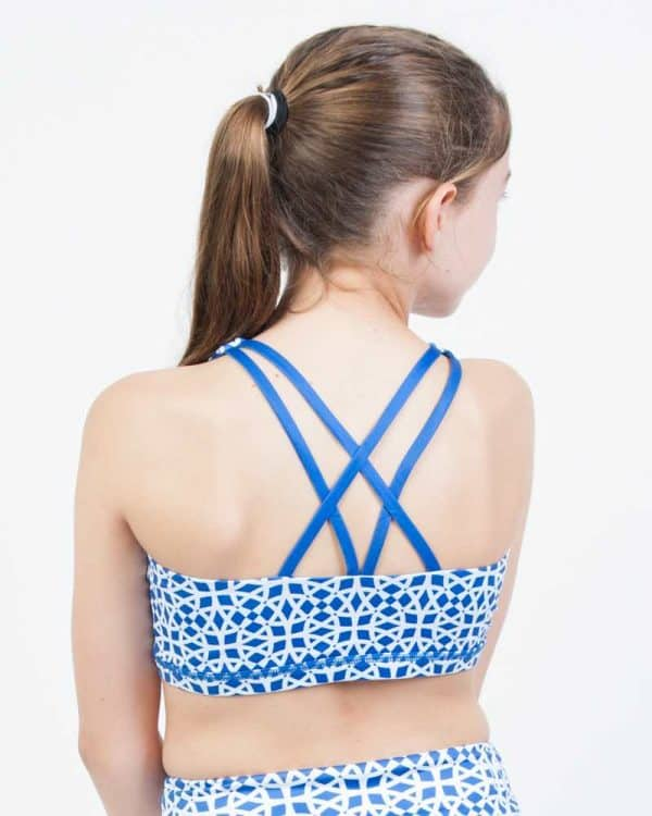 A close-up view of blue, strappy reversible crop.