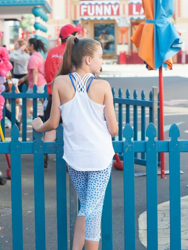 Young athlete wearing tidewater blue coloured Well Being Tights
